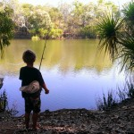 Hendrix fishing at the boat ramp
